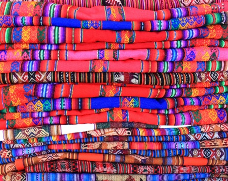 these are the pieces of fabric that Peruvian women use to carry their babies on their backs